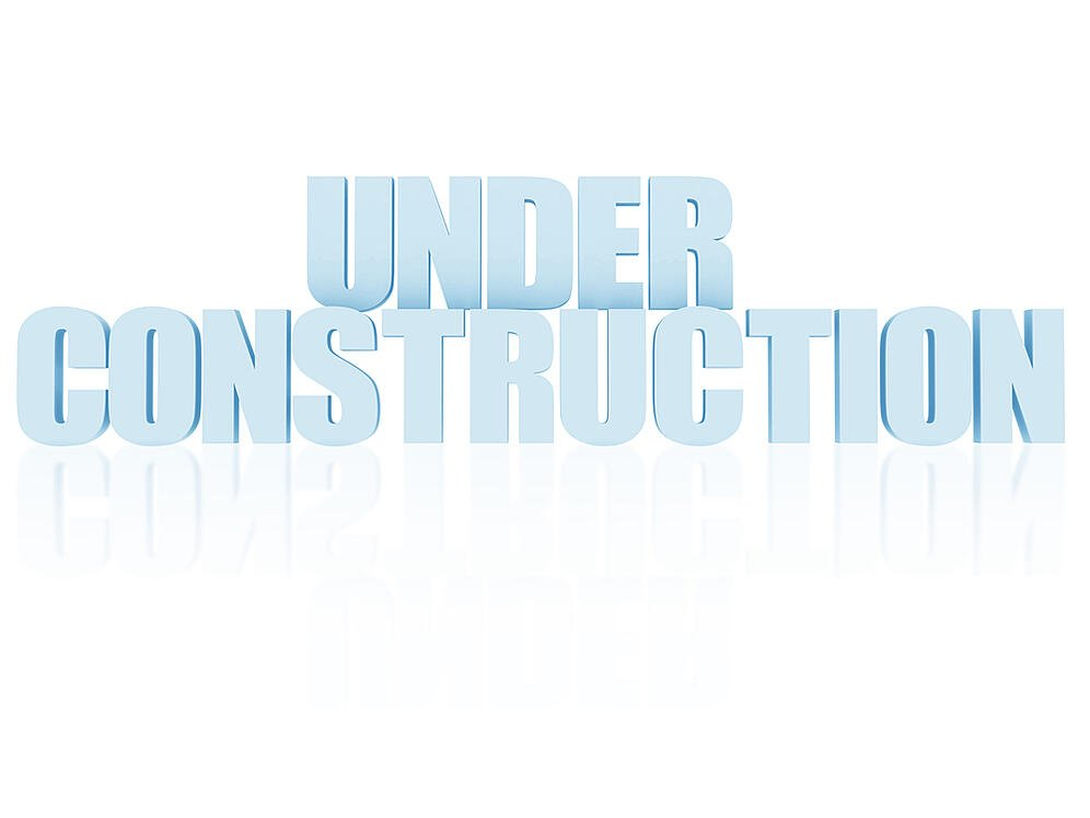 Under construction written isolated over a white background-1